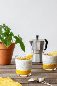 Yogurt in a glass with mango, chia and almonds. healthy eating. vegetarian food. recipe. breakfast. diet.