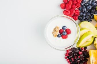 Yogurt near fruits and berries