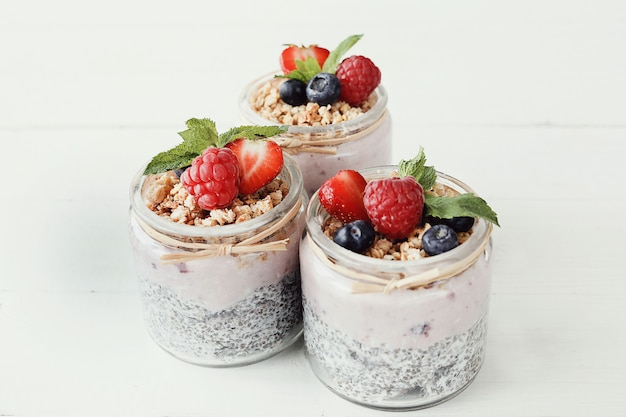 Yogurt with chia seed and berries in glasses