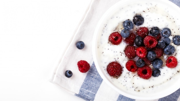 Yogurt with chia seeds and fresh raspberries,blueberries