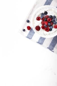 Yogurt with chia seeds and fresh raspberries,blueberries