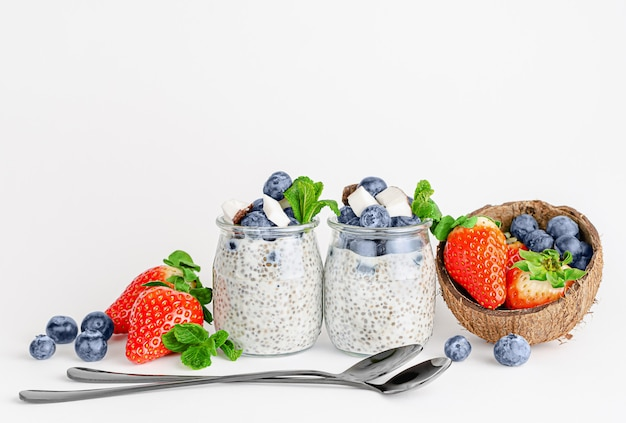 Yogurt with chia seeds, strawberries and blueberries. healthy breakfast. copy space
