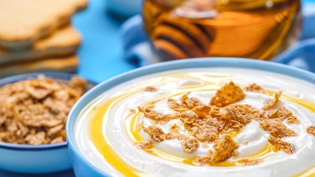 Yogurt with granola and honey