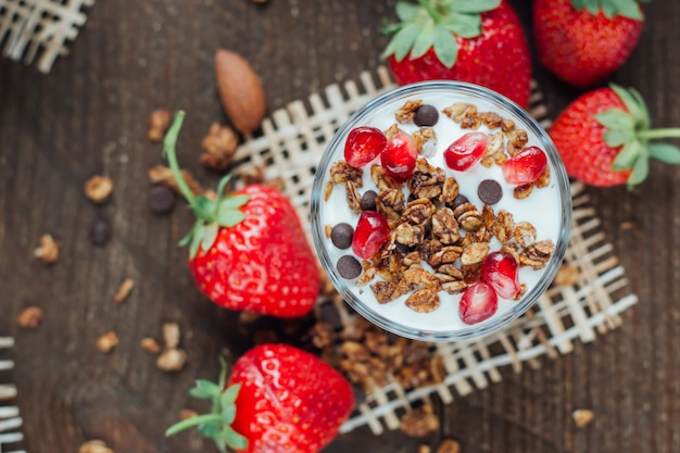 Yogurt with granola and strawberries