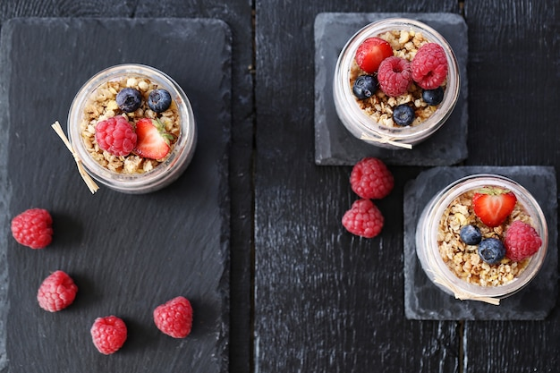 Yogurt with oatmeal and berries in glass