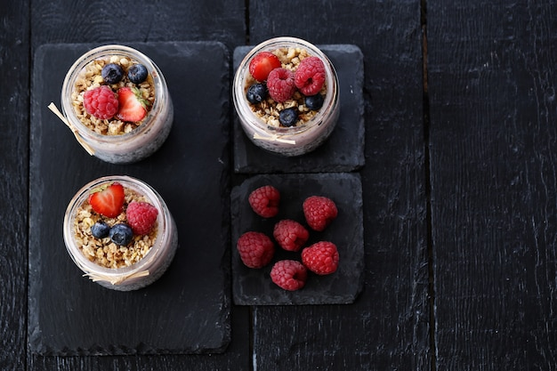 Yogurt with oatmeal and berries in glasses