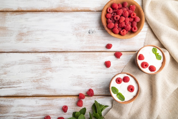 Yogurt with raspberry in clay cups