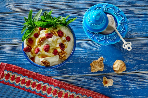 Yogurt with red berries nuts and honey