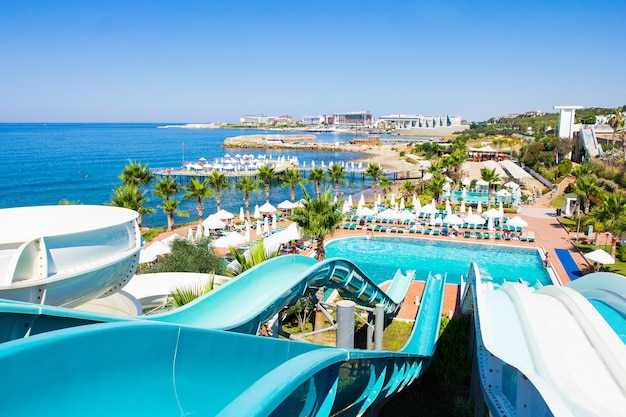 Yop view of aquapark with slides and swimming pool on the seashore in turkey
