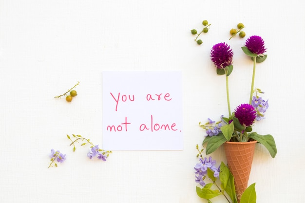 You are not alone message card handwriting with flower