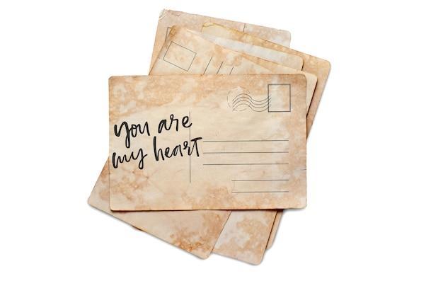 Ты мое сердце. надпись на старинной открытке. изолированные на белом.