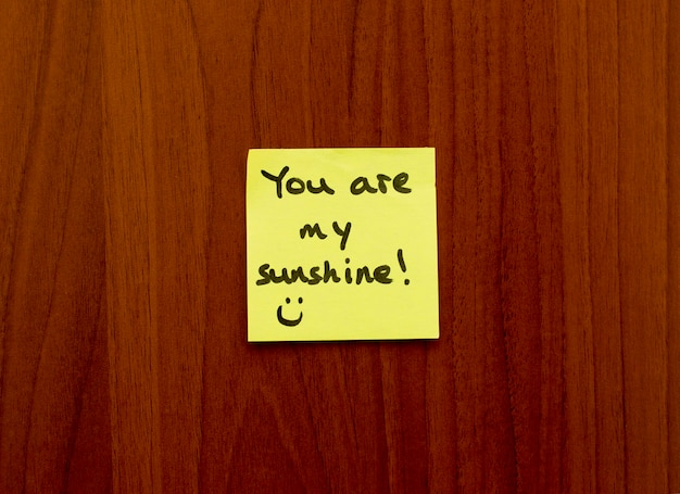 You are my sunhine note reminder yellow sticker on a wall.