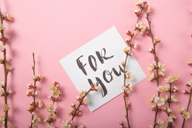 For you handwritten inscription. hand drawn lettering,  calligraphy. card with spring tree brunch background, valentine, mother's day.