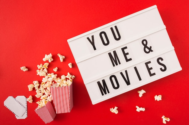 You and me cinema lettering on red background