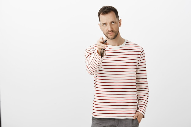 You piss me off, get lost. portrait of outraged angry husband in striped casual clothes