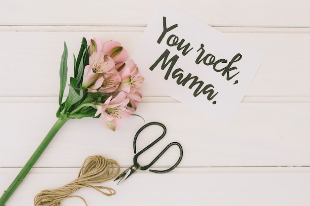You rock mama inscription with flowers