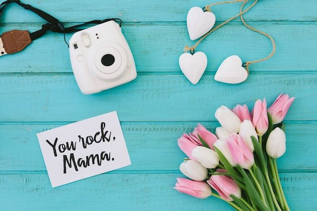 You rock mama inscription with tulips and camera