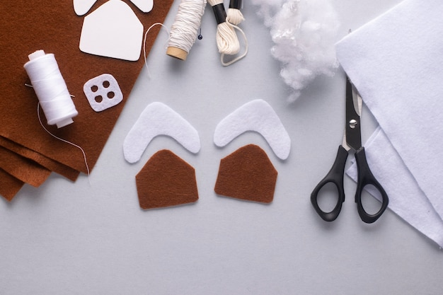 You will need two pieces of felt christmas gingerbread house.