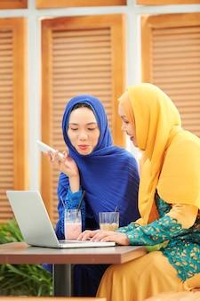 Youg women working on proect for university