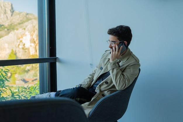 Youn man using mobile phone
