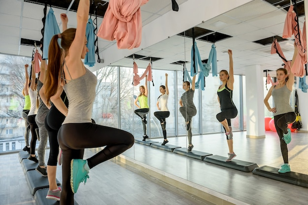 Young and active girls training in gym