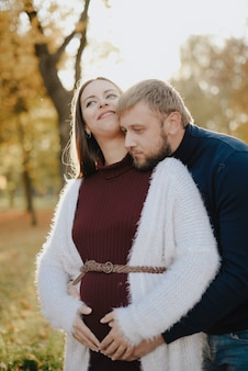 Young adult couple in love in autumn park