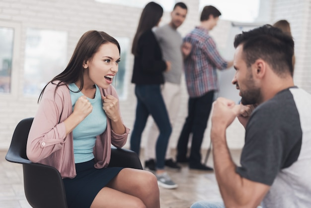 Young adult couple at training anger management