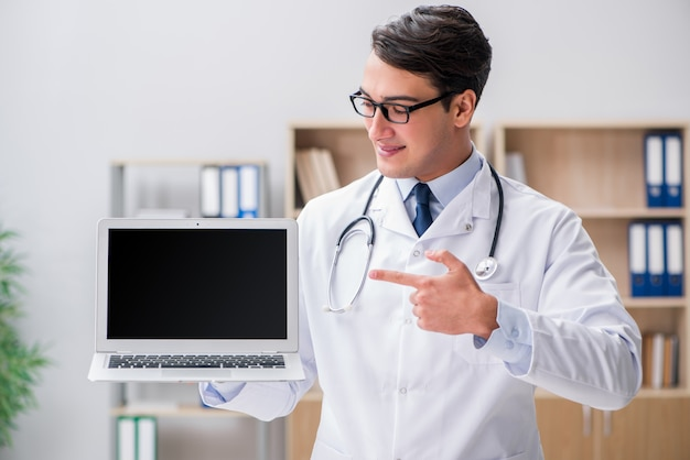 Young adult doctor with laptop computer