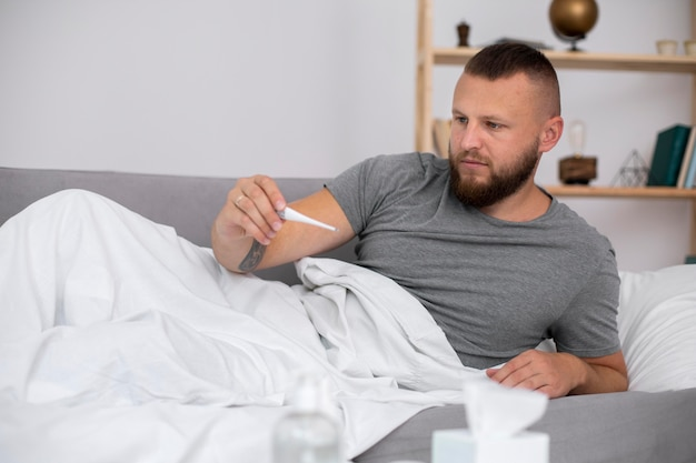 Young adult at home suffering from illness