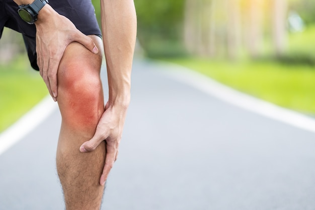 Young adult male with muscle pain during running.