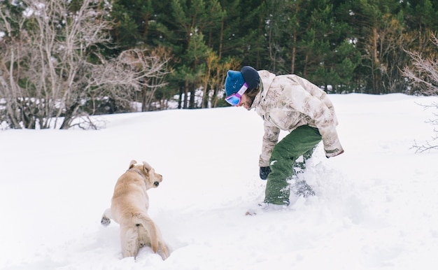 Young adult playing with his dog