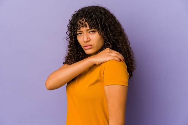 Young african american afro woman isolated having a shoulder pain.