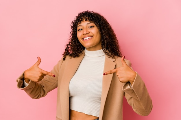 Young african american afro woman isolated points down with fingers, positive feeling.