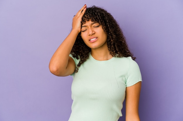 Young african american afro woman isolated tired and very sleepy keeping hand on head.