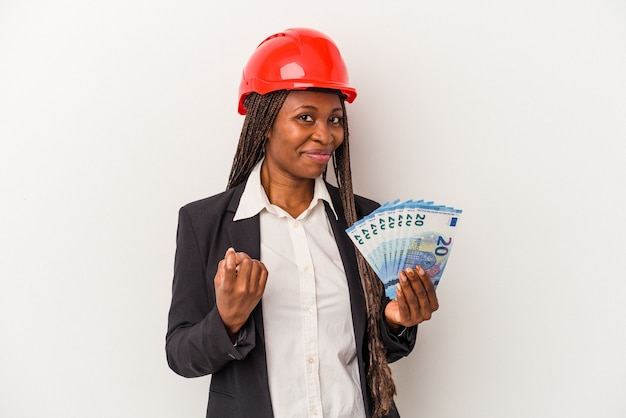 Young african american architect woman holding bills isolated on white background pointing with finger at you as if inviting come closer.