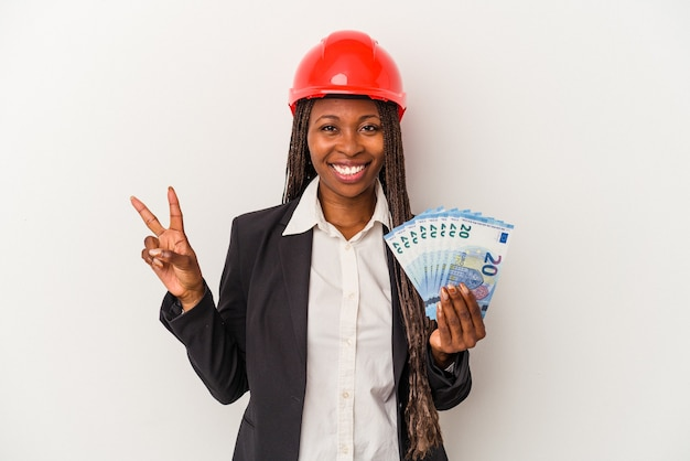 Young african american architect woman holding bills isolated on white background showing number two with fingers.