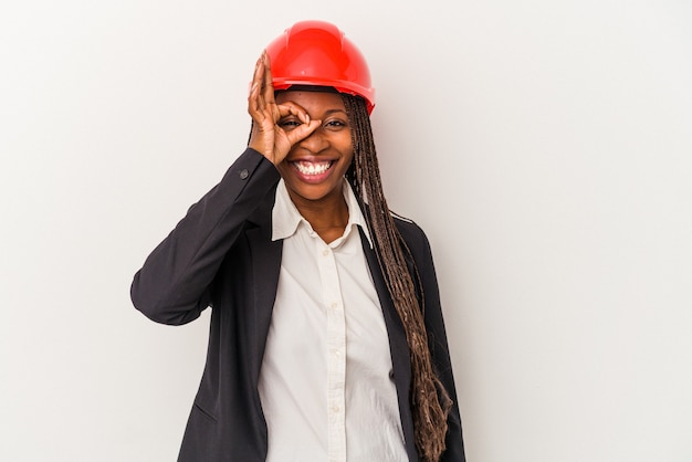 Young african american architect woman isolated on white background excited keeping ok gesture on eye.