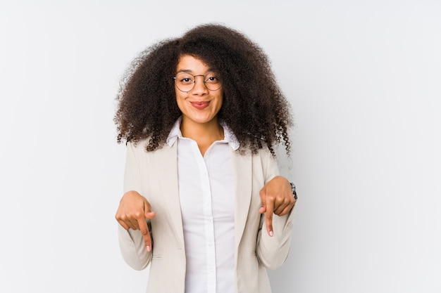 Young african american business woman points down with fingers, positive feeling.