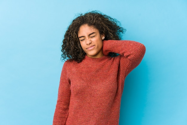 Young african american curly hair woman suffering neck pain