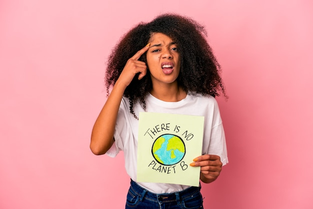 Young african american curly woman holding a there is no planet b placard