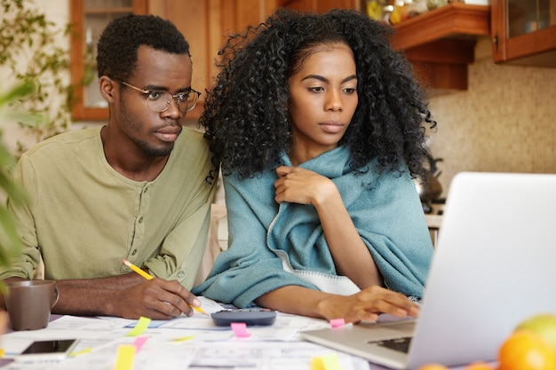 Young african-american family doing paperwork together