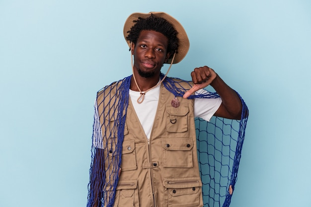 Young african american fisherman holding a net isolated on blue background showing a dislike gesture, thumbs down. disagreement concept.