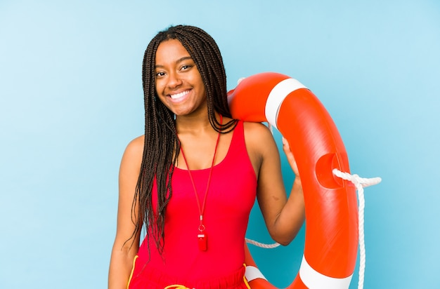 Young african american life guard woman isolated happy, smiling and cheerful.