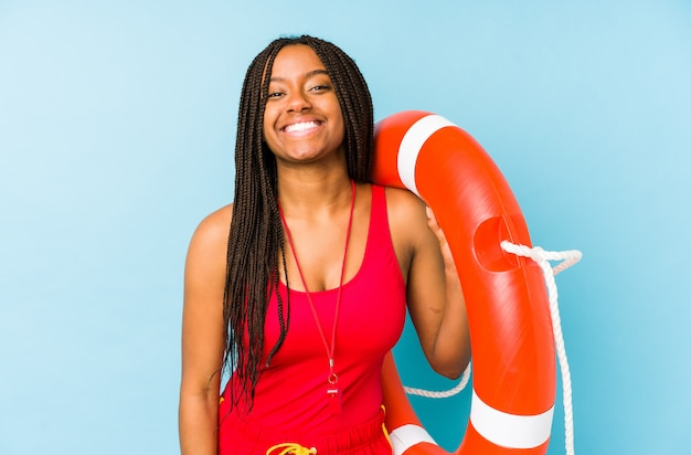 Young african american life guard woman isolated laughing and having fun.