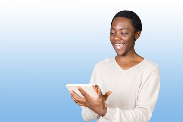 Young african american male holding notepad