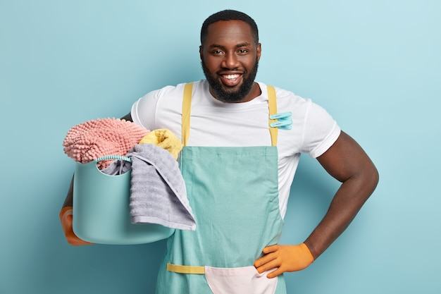 Young african american man doing laundry