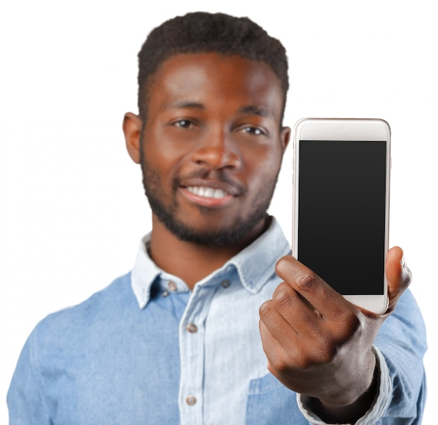 Young african american man holding his smartphone