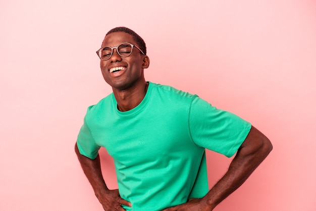 Young african american man isolated on pink background happy, smiling and cheerful.