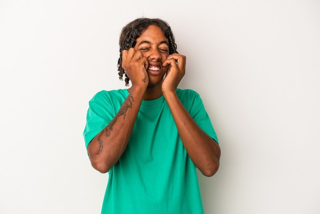Young african american man isolated on white background crying, unhappy with something, agony and confusion concept.