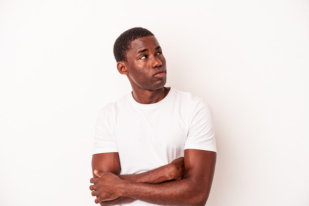Young african american man isolated on white background dreaming of achieving goals and purposes